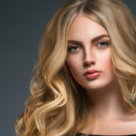 stunning blonade woman with hair extensions posing for a photo