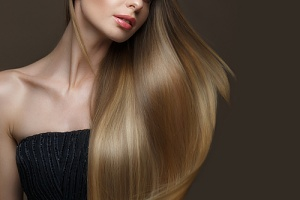 a woman after getting hot fusion hair extensions